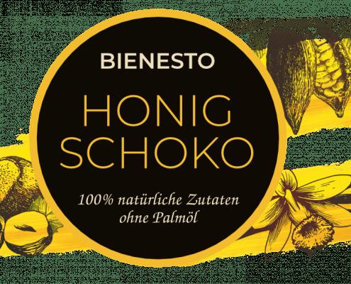 """Etikett der Bio-Nussnougat-Creme """"Honig Schoko"""" mit 100% natürlichen Zutaten ohne Palmöl. Zeichnungen der Zutaten Bio-Haselnuss, Bio-Kakao und Echte Bio-Vanille."""